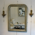 Pair of ormolu wall-lights stamped Leleu Paris with an early 19th C giltwood green french mirror